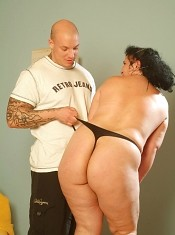 BBW pornstar Belane spreading her legs wide apart as she rides a massive cock
