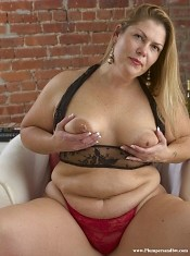 Blond housewife playing with her fat body